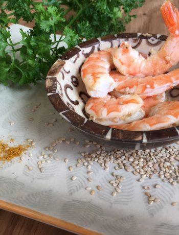 Crevettes sautées à l'orange, curry et sésame